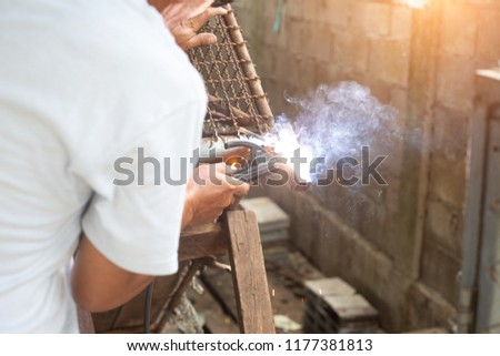 Men are welding iron to make a dog cage.close up #1177381813