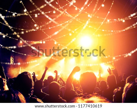 Concert lights over a crowd clapping #1177410619