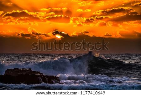 Sunset sea waves horizon landscape. Orange sunset ocean waves on sunset scene. Sunset sea sky clouds view #1177410649