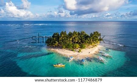 The beautiful Island of Guyam beach paradise near Siargao, Philippines  Royalty-Free Stock Photo #1177486879