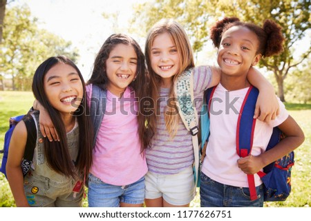 Four young smiling schoolgirls on a school trip #1177626751