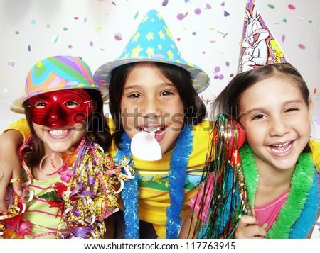 Three funny carnival kids portrait enjoying together. #117763945