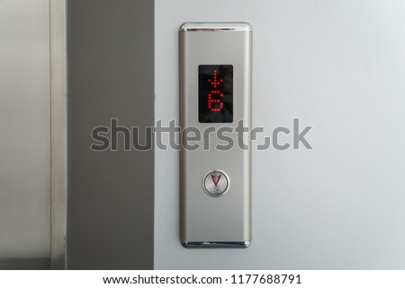 Metallic elevator panel with button and led display.