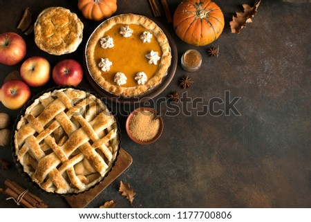 Thanksgiving pumpkin and apple various pies, top view, copy space. Fall traditional homemade apple and pumpkin pie for autumn holiday. #1177700806