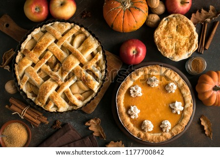Thanksgiving pumpkin and apple various pies, top view, copy space. Fall traditional homemade apple and pumpkin pie for autumn holiday. #1177700842