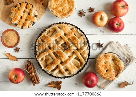 Homemade Apple Pies on white wooden background, top view. Classic autumn Thanksgiving dessert - organic apple pie. #1177700866