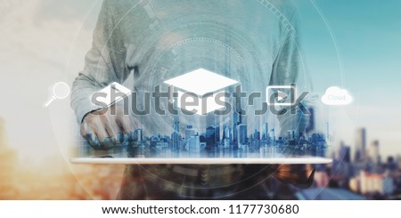 Online education, e-learning and e-book concept. a man using digital tablet for education, with education and online learning media icons #1177730680
