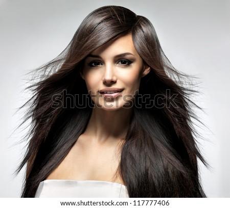 Fashion model with long straight hair. Fashion model posing at studio. #117777406