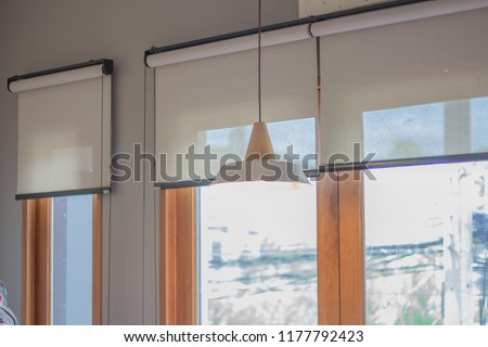 White roller blind and window. #1177792423