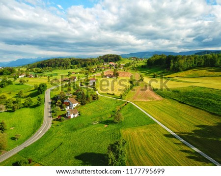 A small, green town in Switzerland near Lake Zurich #1177795699