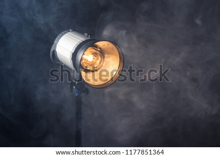 Close-up of professional studio light. Concept photoshoot in the fog