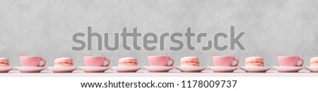 Still life with pink french delicious dessert macaroons and cups of coffee with copy space #1178009737