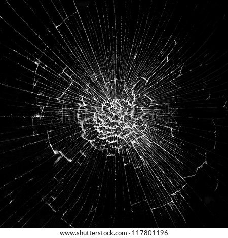 Cracks in the glass on the black background #117801196