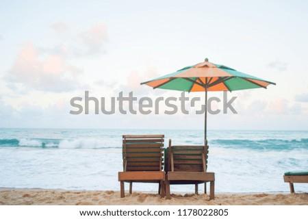 A lone umbrella on beautiful tropical sea. #1178022805
