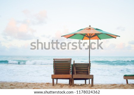Tropical paradise on the beach and blue sky, vacation and holidays. #1178024362