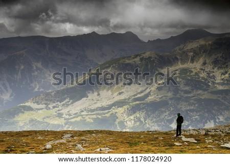 Alpine trekker in National Park Retezat, Romania