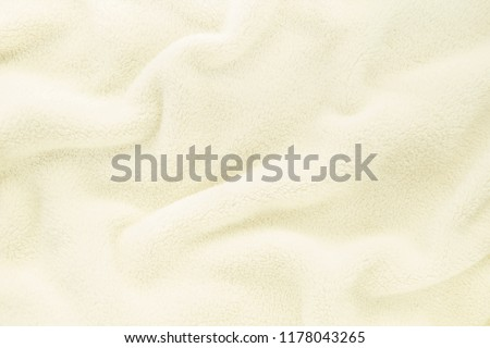 Fluffy Gentle baby beige cream fabric with waves and folds. Soft pastel textile texture. Folds on the soft fabric. Rose towel terry cloth. #1178043265