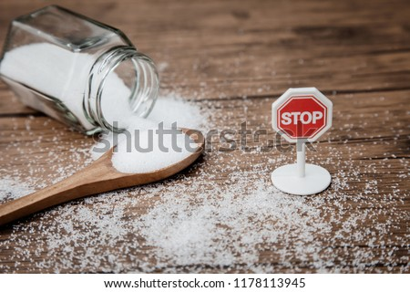 Stop sign on the sugar, warned that the sugar too much will make unhealthy nutrition, obesity, diabetes, dental care and much more. #1178113945