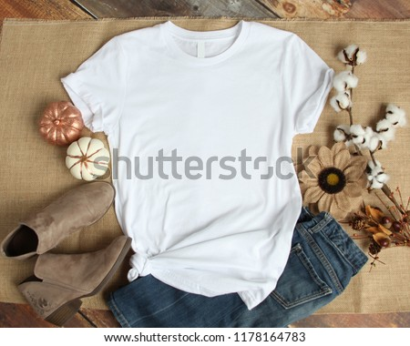 Mockup of a White T-Shirt Blank Shirt Template Photo with Fall accessories and burlap background #1178164783