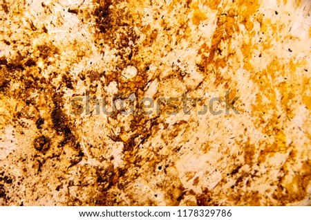 Accumulated dirt, grime, grease, and stains on the base of a steel cooking pan. #1178329786