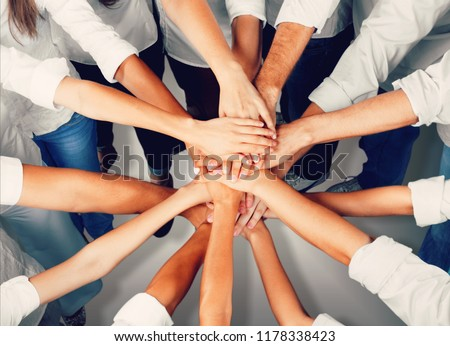Group of people stacking hands together #1178338423