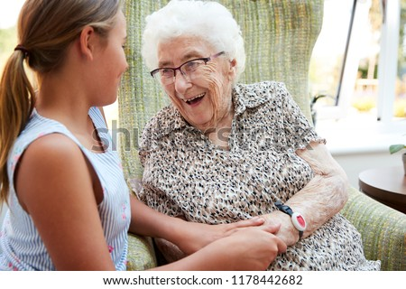 Granddaughter Visiting Grandmother In Lounge Of Retirement Home #1178442682