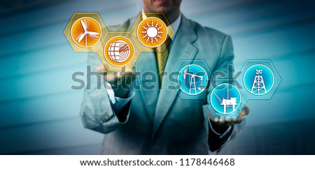 Unrecognizable manager raising renewable energy sector icons above fossil fuel symbols. Industry, business and technology metaphor for transition to alternative power generation, sustainability. #1178446468