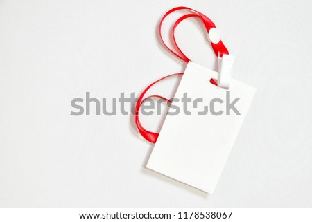 Top view of Blank white badge Mockup isolated on white background. Flat lay creative plain empty name tag. Business office background view. #1178538067