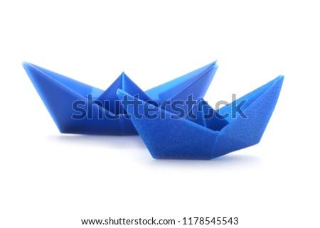 Origami boats on white background #1178545543