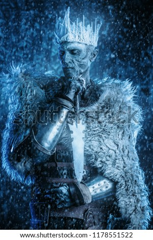 Halloween. The King zombie warrior in the armor of a medieval knight covered with snow. Horror fantasy film. #1178551522