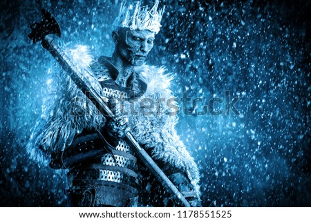 Halloween. The King zombie warrior in the armor of a medieval knight covered with snow. Horror fantasy film. #1178551525