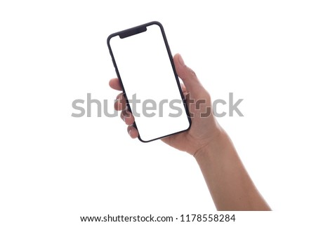 New version of smartphone iphone xs with blank screen in woman hand on white background. Flat lay, top view. #1178558284