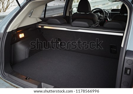 Clean, open empty trunk in the car SUV Royalty-Free Stock Photo #1178566996