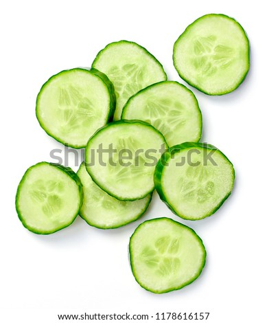 Fresh cucumber slices, isolated on white background. Close up shot of cucumber, arrangement or pile. #1178616157