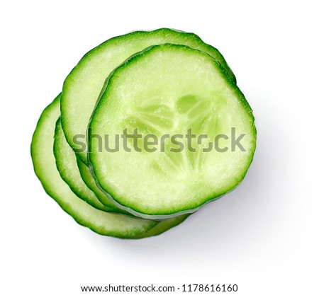 Fresh cucumber slices, isolated on white background. Close up shot of cucumber, arrangement or pile. #1178616160