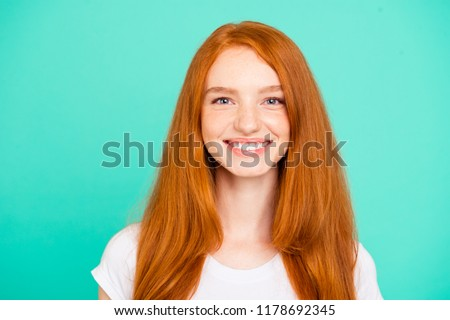 Portrait nice cheerful positive cute bright vivid shiny red straight-haired girl, isolated over turquoise green teal pastel background #1178692345