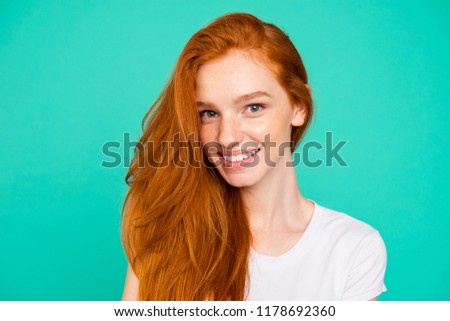 Close up portrait of beautiful, sweet, gorgeous, nice, stunning, adorable, good-looking woman in white t-shirt look at camera isolated on bright turquoise background #1178692360