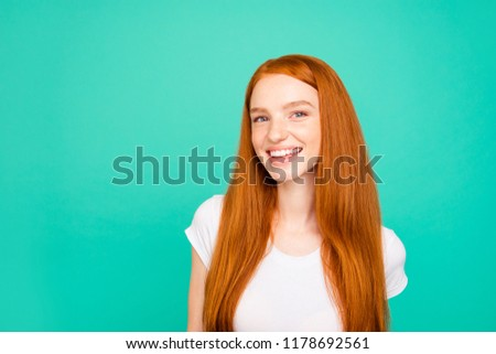 Portrait of nice glad positive cheerful attractive cute bright vivid shiny red straight-haired girl in casual white t-shirt, having fun, isolated over turquoise green teal pastel background #1178692561