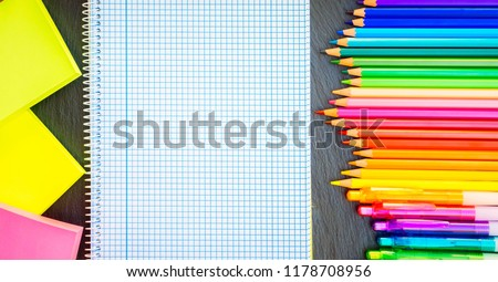 Back to school pencils and pens rainbow and ruled notebook, retro toned #1178708956
