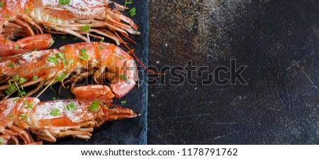 Grilled shrimps with lemon on wood close up #1178791762