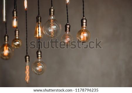 Set edison retro lamp on loft gray concrete background. Concept idea #1178796235