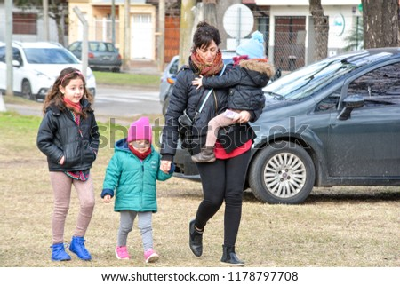 RAFAELA, ARGENTINA - JULY 22, 2018: family with children laughing and playing #1178797708