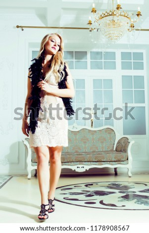 pretty blond woman in rich luxury house interior, fashion people #1178908567