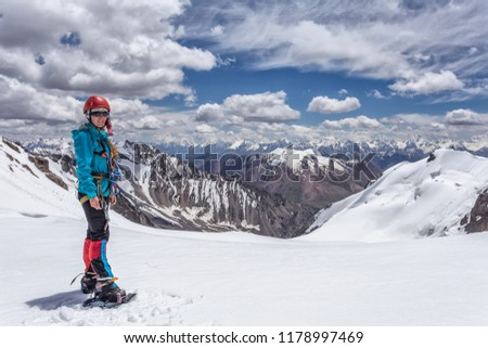 Girl mountaineer in the mountains among the mountain scenery on the pass. Mountain trekking, a trip to the mountains #1178997469