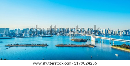 Asia Business concept for real estate and corporate construction - panoramic modern city skyline bird eye aerial view of Odaiba, tokyo tower & rainbow bridge under blue sky in Tokyo, Japan #1179024256