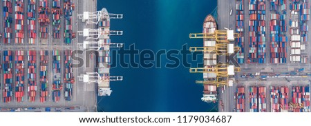 Aerial view panoramic sea port warehouse and container ship or crane ship working for delivery containers shipment. Suitable use for transport or import export to global logistics concept. #1179034687