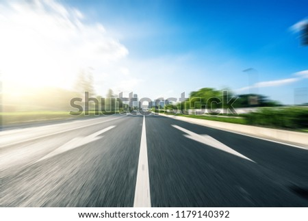 empty asphalt road with city skyline #1179140392