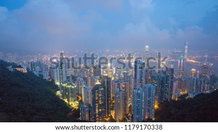 a big asia city by night to the sunrise with all the lights on the streets and skyline #1179170338