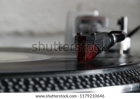 Vinyl record with needle on turntable #1179210646