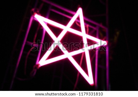 pink star neon in the local festival  #1179331810